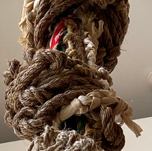 Lynnette Haozous  Braiding Reconciliation (detail)  2018  Manila rope, corn husks, yucca, wool, wood, rocks  Courtesy of the Artist