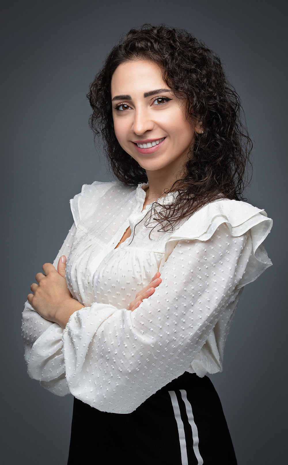 Lady posing for a professional corporate headshot