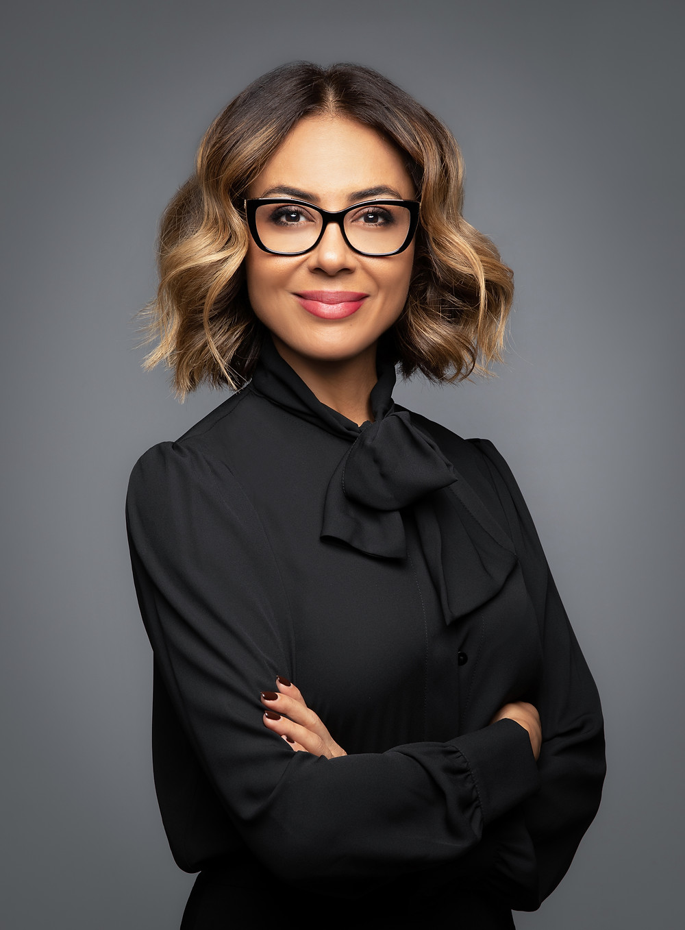 Lady posing for a corporate headshot