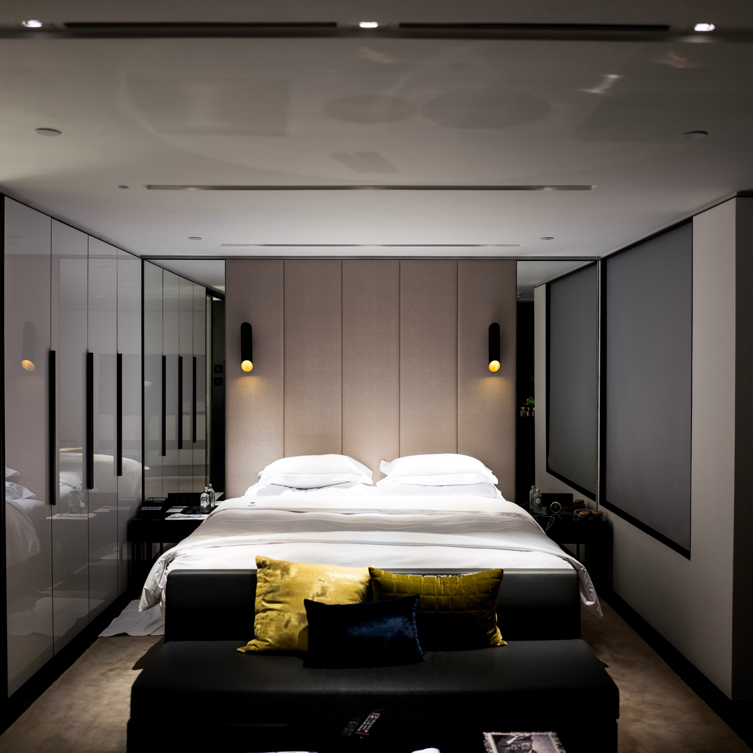 Interior photography of a bedroom with mirrors and lighting