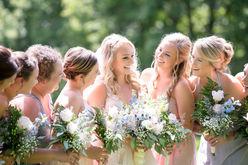 Bridesmaids holding wedding bouquets - Wedding reception photography company in Dubai and Abu Dhabi