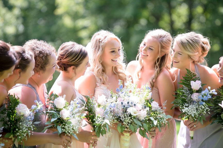 Bridesmaids holding wedding bouquets - Wedding reception photography company in Dubai and Abu Dhabi