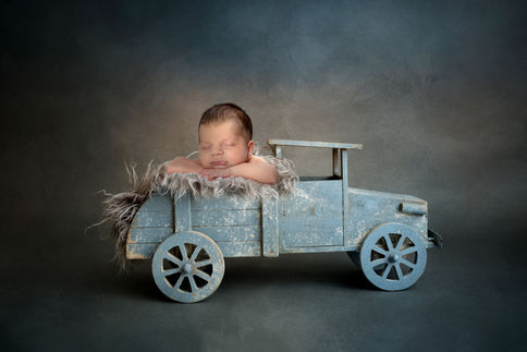 Baby boy in a blue truck photography