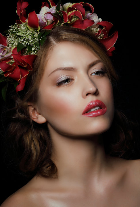 Fashion, beauty and lifestyle portraiture: Girl with beautiful makeup and creative hair with flowers.