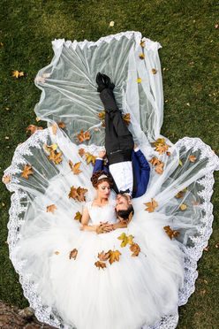 Aerial wedding photography of bride and groom laying on grass – Destination wedding photographers in Dubai