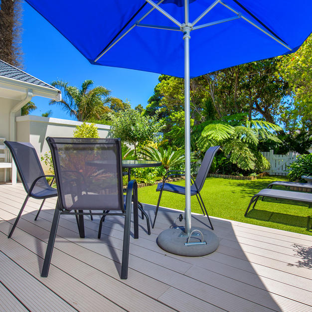 Private Garden with an Umbrella,Chairs,Table & Loungers
