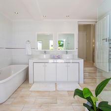 Bathroom with Large Bath,Double Basins & Heated Towel Rail.