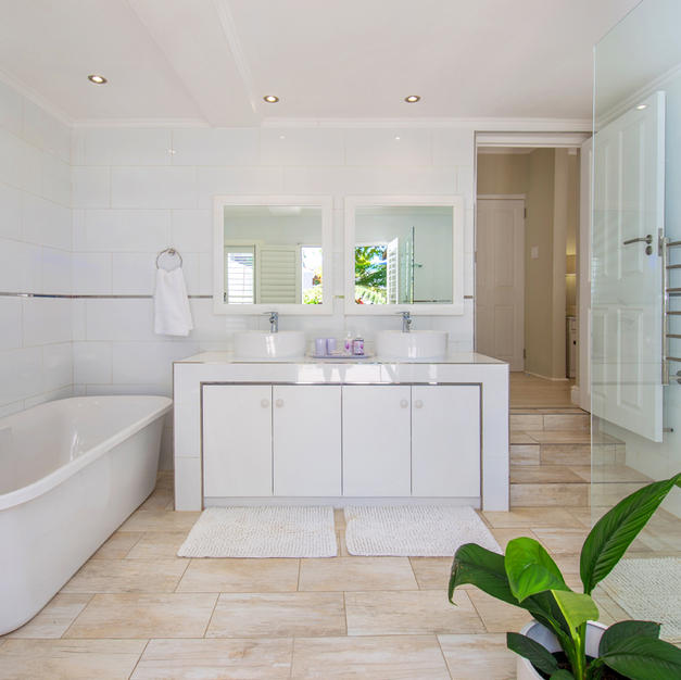 Bathroom with Large Bath,Double Basins & Heated Towel Rail.