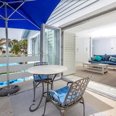 Private Balcony with Table Chairs & anUmbrella