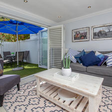 Sitting Area with Outside Table,chairs & an Umbrella