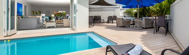 Pool with sun loungers & sitting area