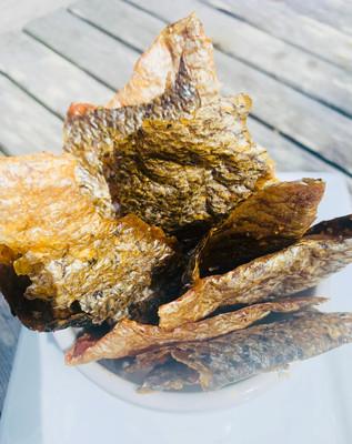 Crispy salmon skin, gluten-free canapé base.