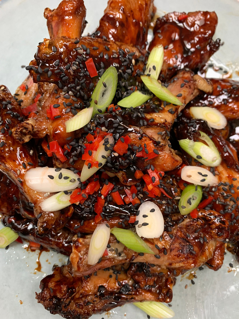 Hoisin, sesame and soy glazed sticky Chicken wings with chilli and spring onion