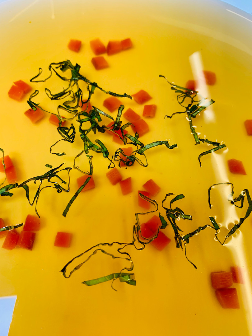 Vegetarian: vegetable consomme with red pepper brunoise and basil chiffonade