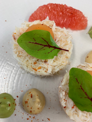 Crab with grapefruit jelly and avocado mousse and micro herbs