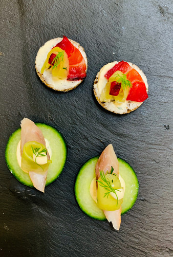 Gluten-free canapes with cucumber, mackerel and salmon