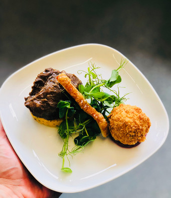Slow-roasted pork cheek with pork crackling and croquette