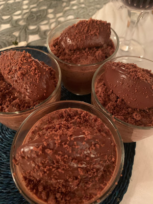 Chocolate mousse with chocolate truffle quenelle and chocolate chips