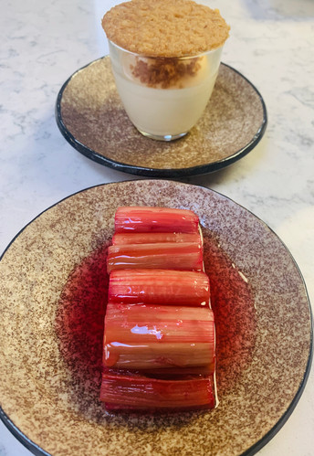 Dessert for celebration dinner with private chef: vanilla panacotta with ginger crumb and poached rhubard