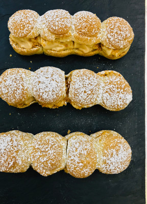 Paris-Brest choux pastry with creme patisserie and caramel