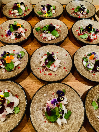 Mass catering for a wedding party: sea bass ceviche with chilli, coriander and edible flowers