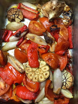 Roasted vegetables including red peppers and garlic