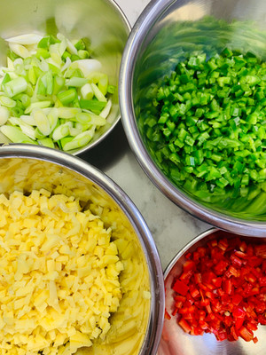 Ingredients for a laksa: finely diced vegetables, herbs, mise en place