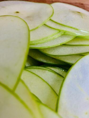 Finely sliced apples for making apple crisps sous vide