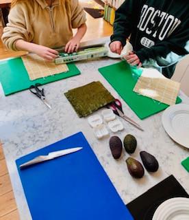 Teaching teenagers to make sushi and sashimi