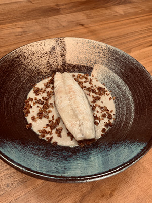 Starter for a celebration meal or dinner party: mackerel on a mushroom cream with pancetta crumb