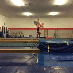 Mary, our level 6, holding a handstand on beam