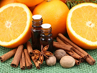 oranges, herbs and essential oils bottle