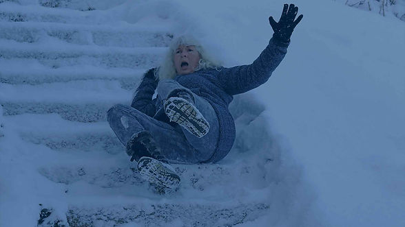 Woman slipping on snowy stairs