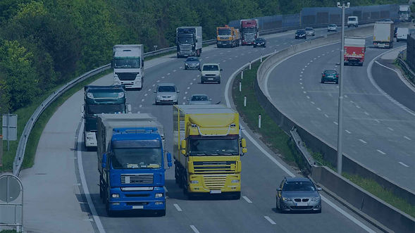 Trucks driving on a busy highway