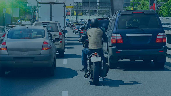 person riding motorcycle on crowded street