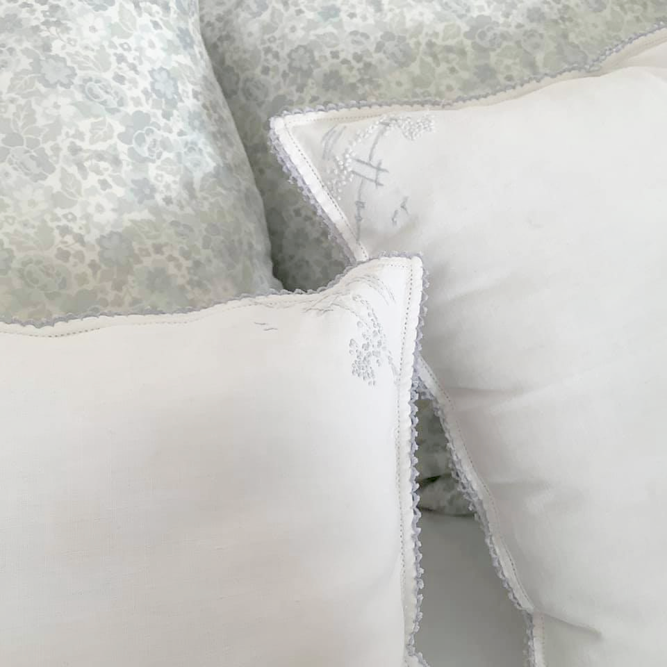 handmade white and blue accent pillows made from vintage cloth napkins