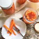 fermented carrot sticks in white bowl with fork