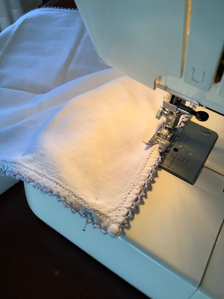 vintage napkins being sew together to make a pillow
