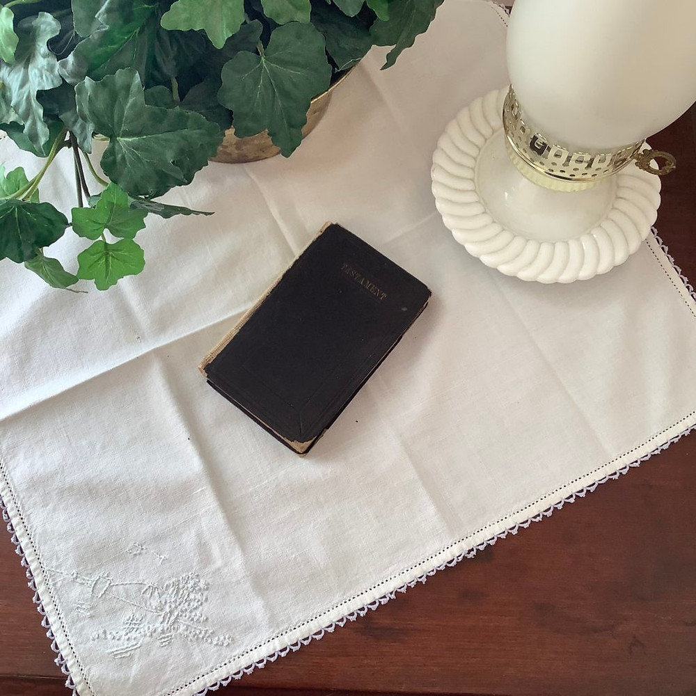 linen napkin on table with lamp and plant