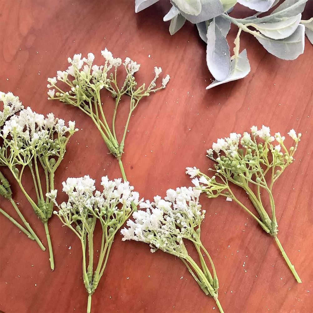 artificial flower stems on a table