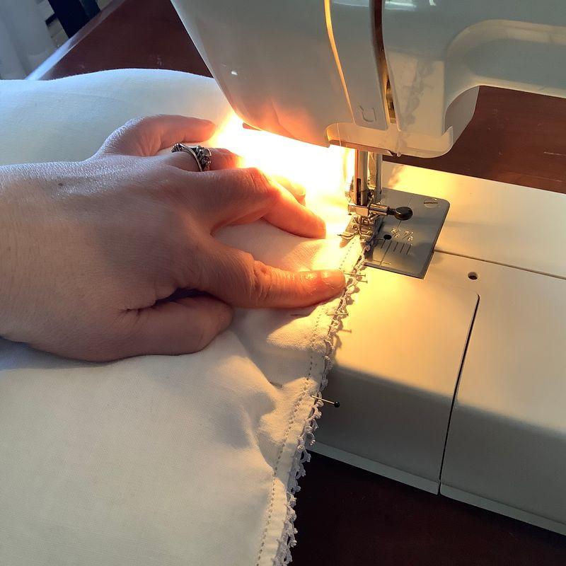 hand holding material as it is being sewn