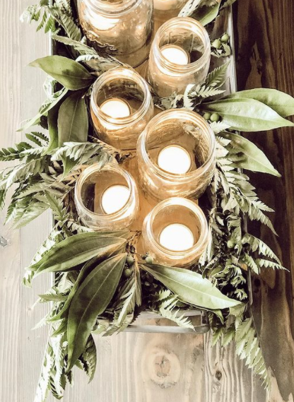 green leaves and candles on a table