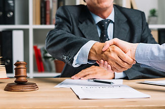 lawyer-his-client-shaking-hands-together