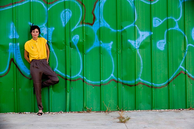 Girl on Green Wall