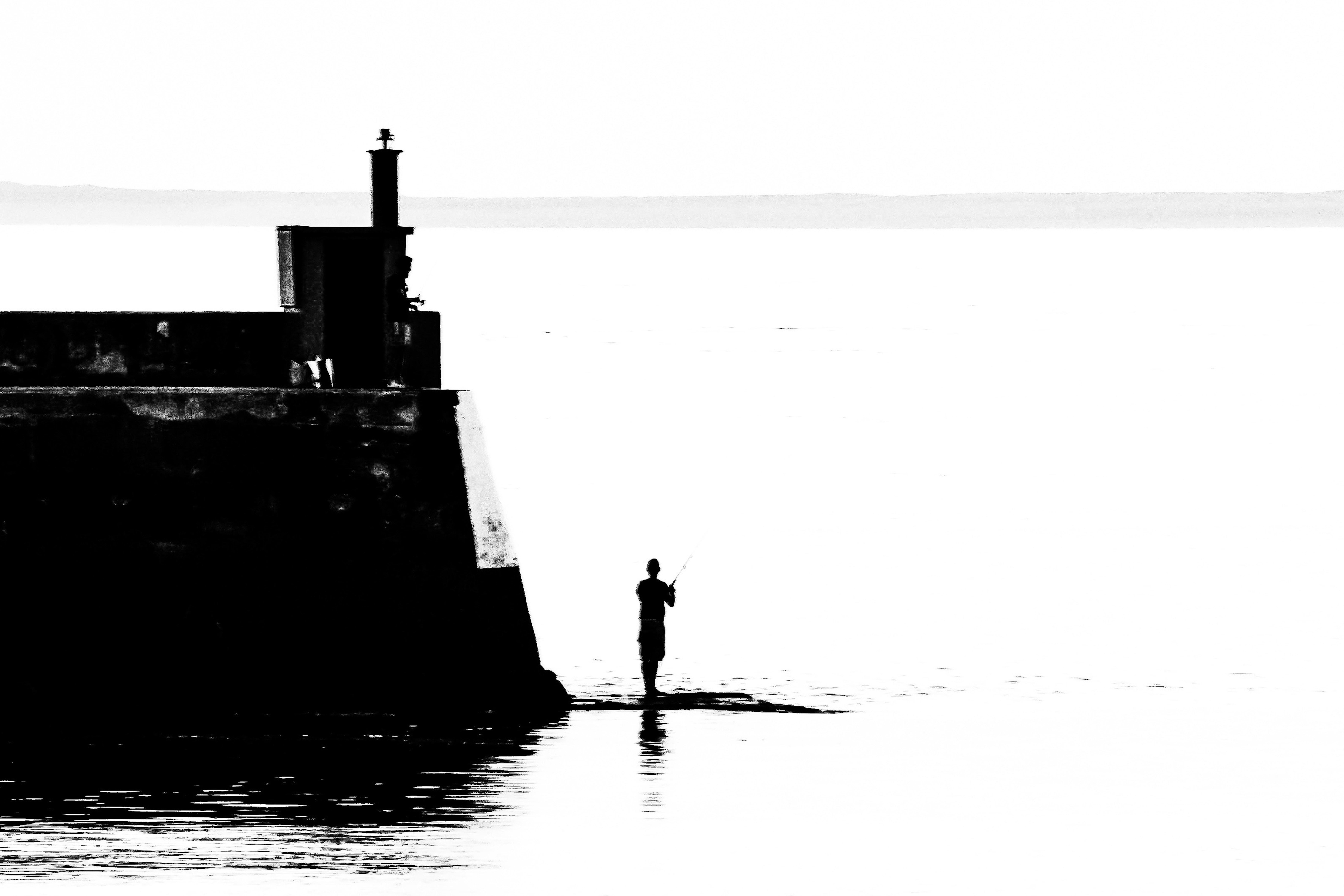 Le pêcheur de la digue