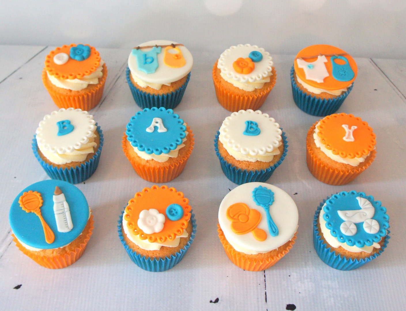 Orange and Blue baby shower cupcakes.jpg