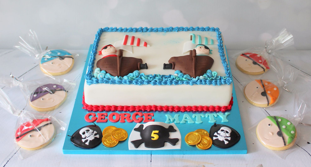 Pirate ship cake with matching biscuits
