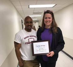 Kevin at WakeMed presenting Emma's mother with the first scholarship of 2018