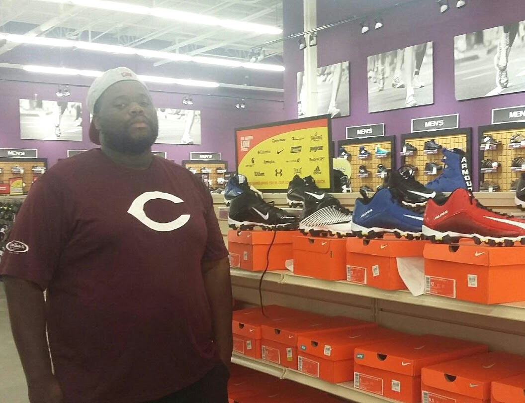Coach Jerome picking out the cleats!