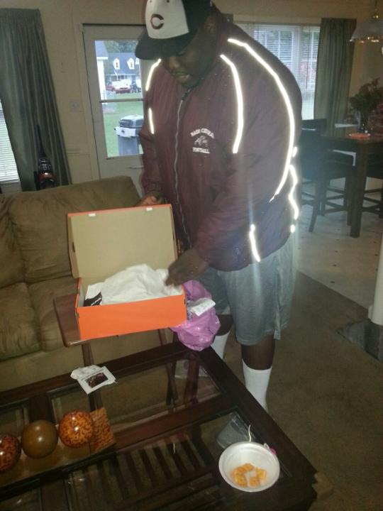 Coach Jerome picking up the cleats!